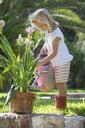 Girl watering garden plant - CUF35263
