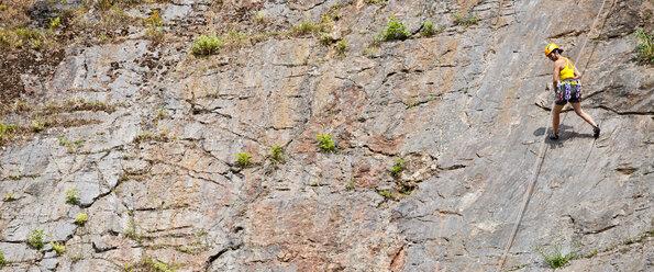 Female climber abseiling down