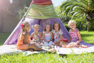 Portrait of five girls in front of teepee - CUF35353