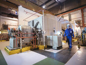 Engineer in generator room of power station - CUF35419