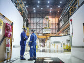 Engineers in discussion in reactor hall in nuclear power station - CUF35521