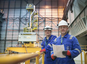 Portrait of engineers in reactor hall in nuclear power station - CUF35524