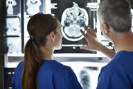 Radiologists looking at brain scans - CUF36012