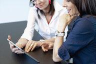 Businesswomen using digital tablet - CUF36045