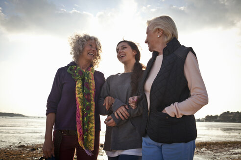 Female family members chatting on beach - CUF36339