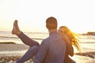 Couple having fun on beach - CUF36366