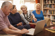 Senior man and female companions in retirement villa - CUF36591