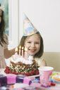 Portrait of young girl enjoying her birthday party - CUF36654