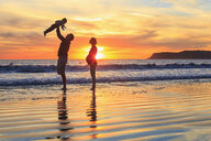 Family with toddler son playing on beach, San Diego, California, USA - ISF14434
