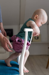Baby girl standing on chair - CUF36758