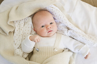 Baby girl lying on bedclothes - CUF36782