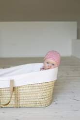 Portrait of baby girl in moses basket - CUF36791
