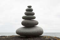 Six coastal stones balanced on top of each other - CUF37004