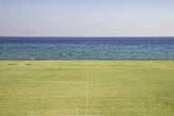 Greece, Peloponnese, Messenia, Koroni, soccer field at seashore - MAMF00116