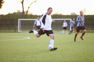 Football player kicking ball - CUF37106