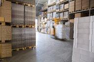 Blurred forklift truck in storage warehouse - CUF37139