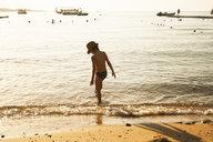 Boy playing by seaside, Sharm El Sheikh, Egypt - CUF37361