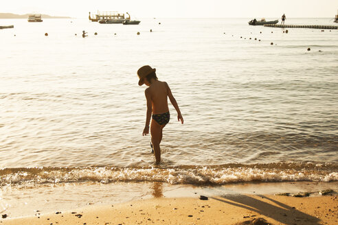 Boy playing by seaside, Sharm El Sheikh, Egypt - CUF37361