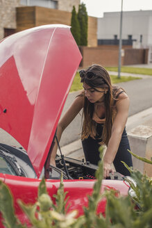 Young woman having a car breakdown - ACPF00061