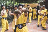 Vietnam, Hanoi, men exercising kung fu - WPEF00518