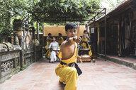 Vietnam, Hanoi, young man exercising Kung Fu - WPEF00530