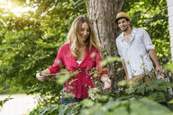 Young couple gardening - CUF37475