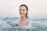 Portrait of smiling mid adult woman in sea, Sardinia, Italy - CUF37496