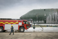 Fireman and fire engine at airport training facility - CUF37637