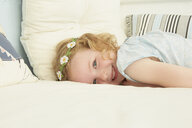 Portrait of girl lying on seat in holiday apartment - CUF37652