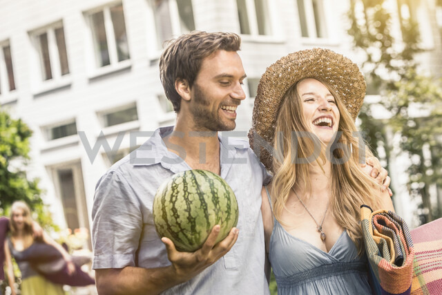 Couple with watermelon laughing - CUF37772