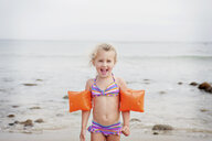 Young girl with armbands on the beach - ISF14577
