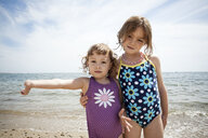 Portrait of two young sisters on beach at Falmouth, Massachusetts, USA - ISF14647