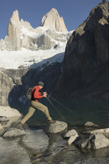 Man on stepping stones, El Chalten, Los Glaciares National Park, Argentina - ISF14805