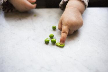 Toddler girl squashing pea - ISF14823