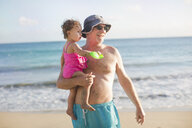 Grandfather and granddaughter on beach - ISF14904