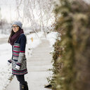 Young woman standing on ice covered street - ISF15006