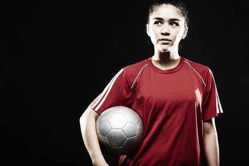 Young woman holding football - ISF15018