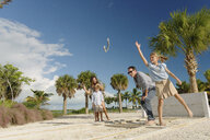 Family playing horseshoe game, Providenciales, Turks and Caicos Islands, Caribbean - ISF15102