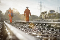 Maintenance workers on railway, rear view - CUF37963