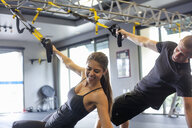 Couple working out in gym - ISF15159