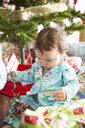 Baby girl opening christmas presents on her first Christmas - ISF15171