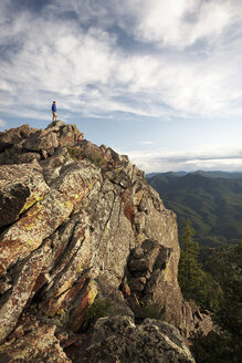 Man standing on rock formation, Boulder, Colorado, USA - ISF15228