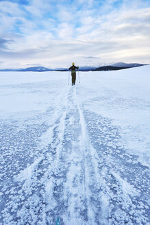 Mid adult woman skiing across vast landscape, Colter Bay, Wyoming, USA - ISF15231