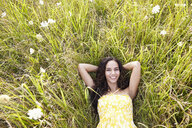 Woman in field of wildflowers - ISF15327