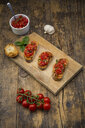 Bruschetta with tomato and basil on wooden board - LVF07175