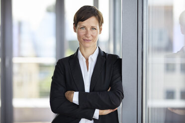 Portrait of smiling businesswoman in office - RBF06359