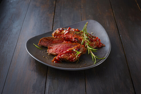 Beefsteak with rosemary on plate - KSWF01936