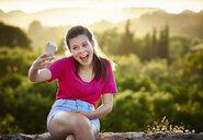Teenage girl making face for selfie on smartphone, Majorca, Spain - CUF38107