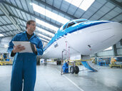 Engineers working on aircraft in aircraft maintenance factory - CUF38320