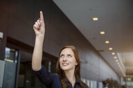 Young businesswoman gesturing with finger in office - ISF15443